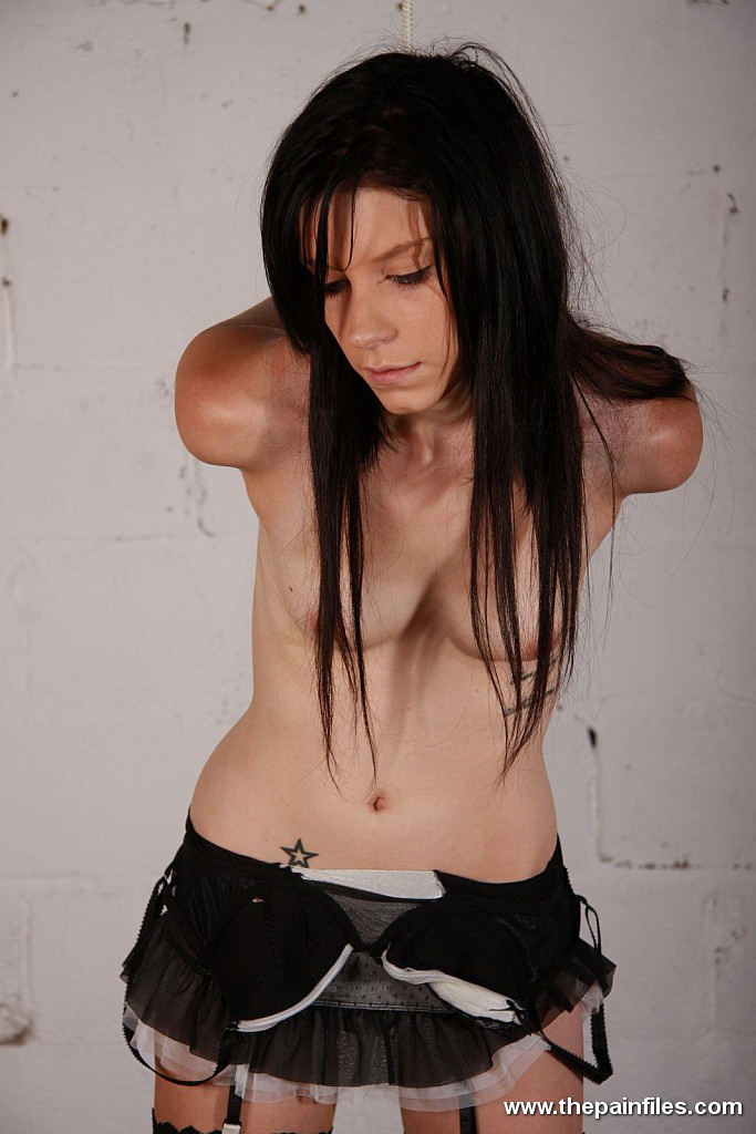 Amateur slender brunette Vanessa is cuffed with leather in the stables ...