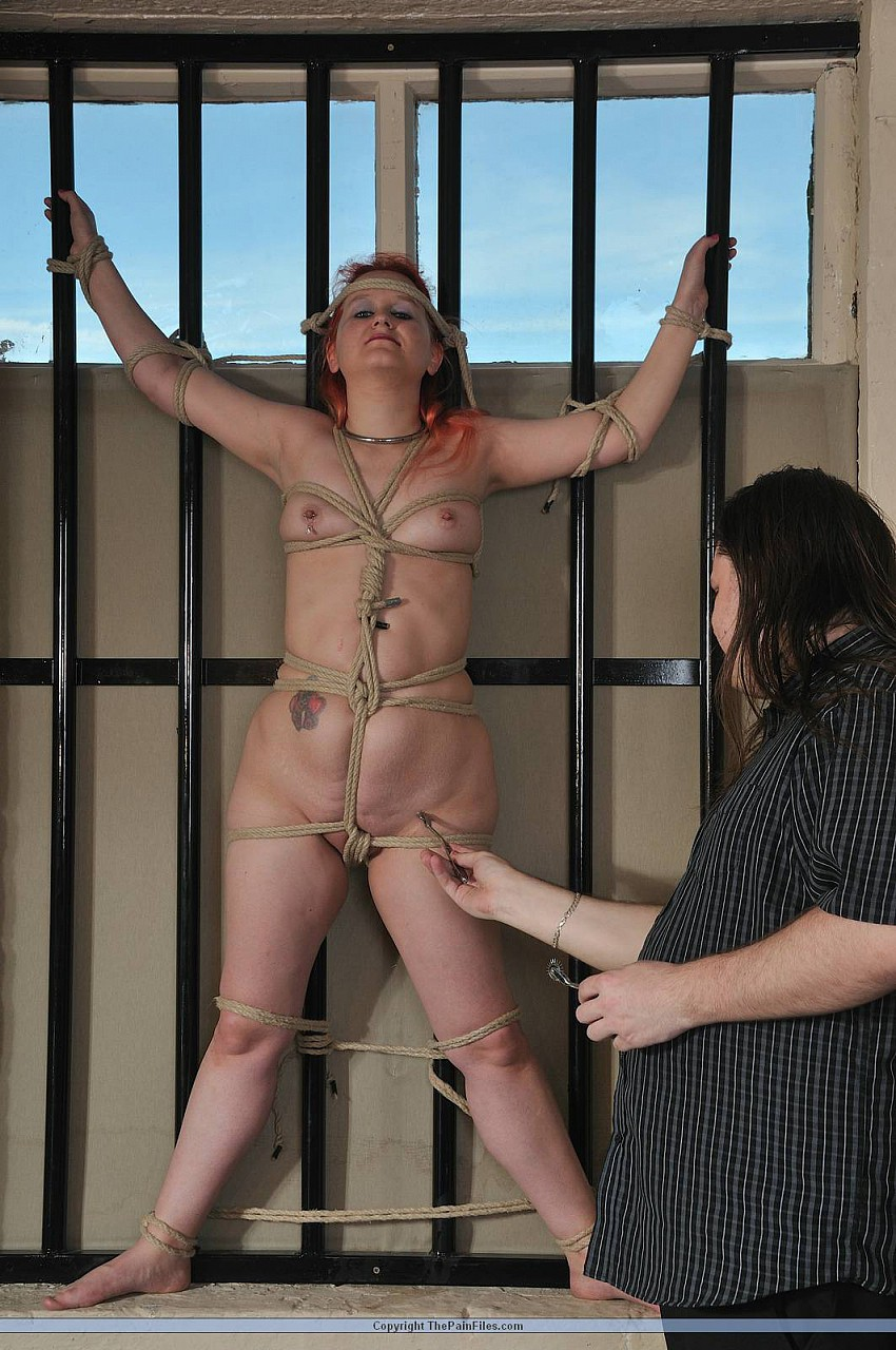 Lesbian prison guard tortures slaves small titties in cage BDSM