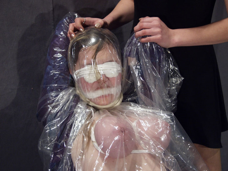 Bizarre plastic wrap bondage and pussy punishments